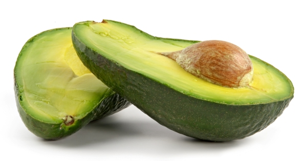 Avocado-oily nutritious fruit.Two fleshy halfs on white background